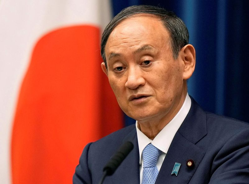 Japan PM Suga intends to dissolve parliament mid-Sept, delay party chief race -media
