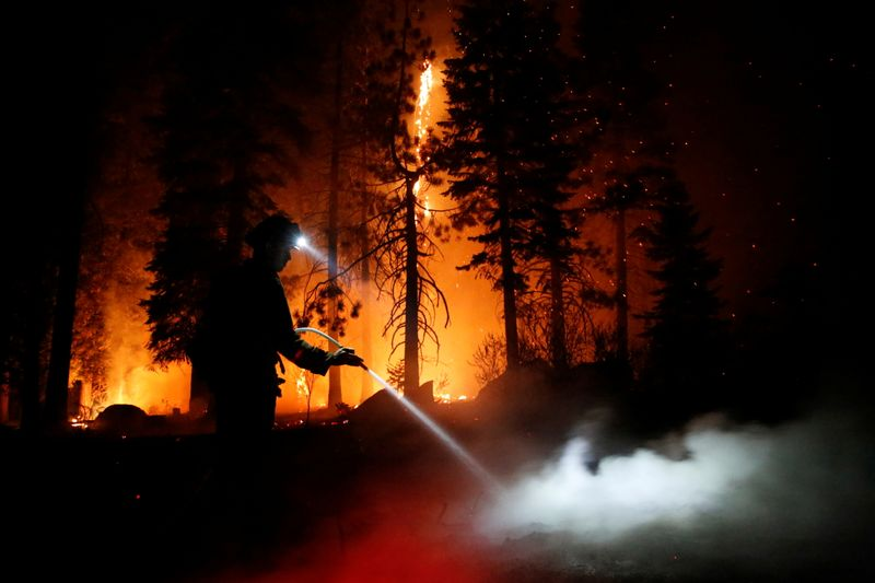 Crews save California town near Lake Tahoe; wildfire rages on