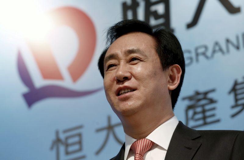Evergrande's billionaire boss exudes calm as debt risks grow