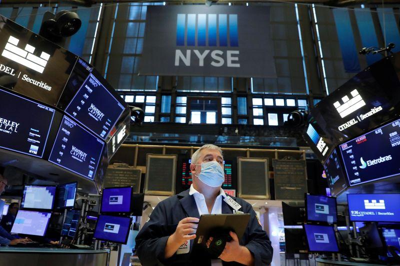 Tech stocks power Nasdaq to record high; PVH Corp surges