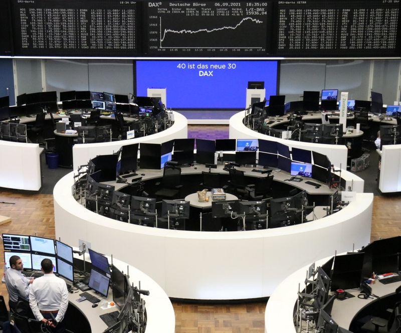 European shares hover below record high, telecom stocks jump