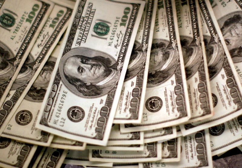 Dollar gains with yields as Fed policy in focus