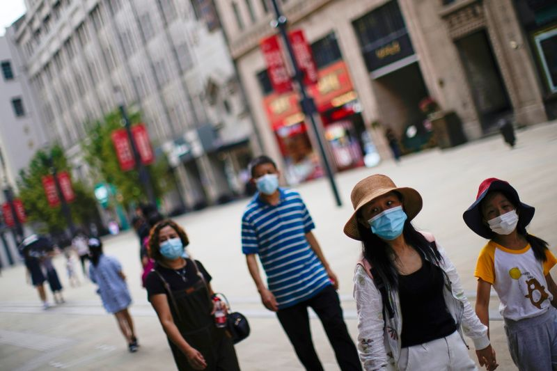 Chinese city imposes travel curbs, closes public venues in new COVID-19 outbreak