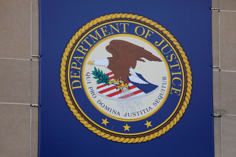 U.S. Justice Dept scales back use of chokeholds and no-knock warrants