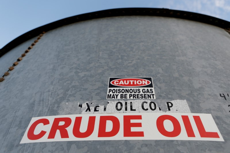 © Reuters. FILE PHOTO: A sticker reads crude oil on the side of a storage tank in the Permian Basin in Mentone, Loving County, Texas, U.S. November 22, 2019. REUTERS/Angus Mordant