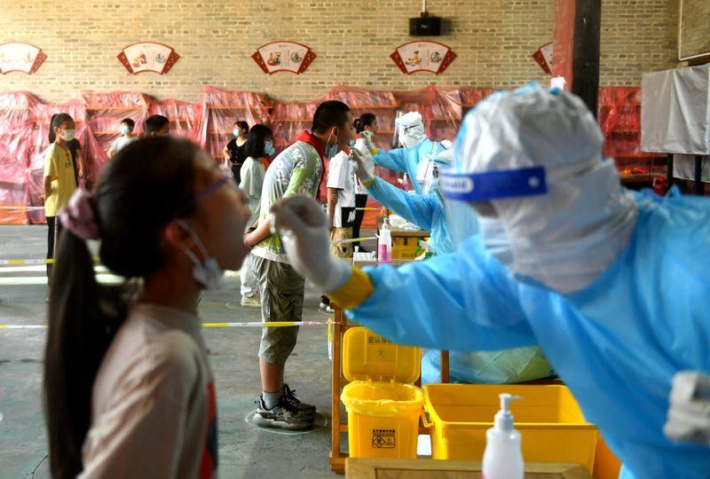 Chine: Nouvelles contaminations dans le Fujian, alertes sur les déplacements