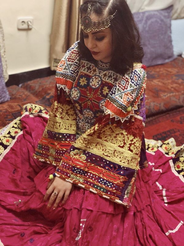 'This is how we dress': Afghan women overseas pose in colourful attire