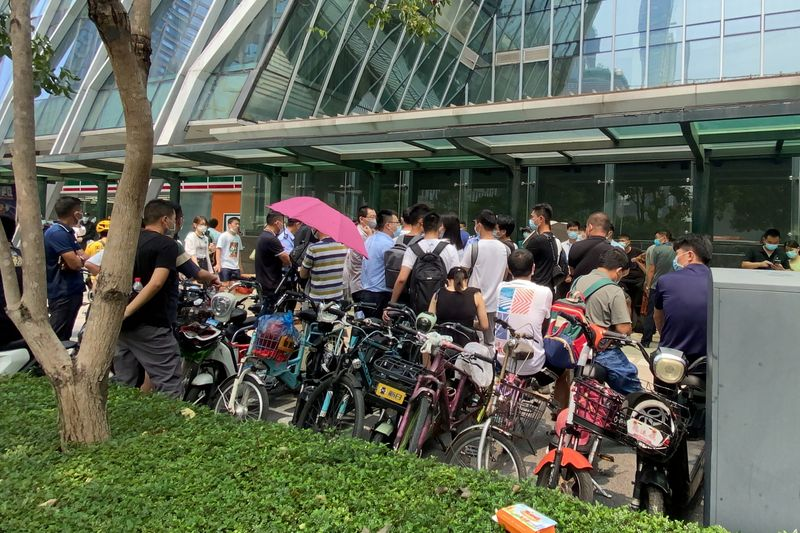 Protesters taken away outside China Evergrande headquarters