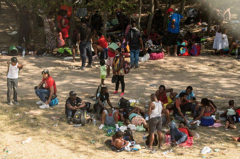 Thousands of migrants converge under Texas bridge, posing new challenge for Biden