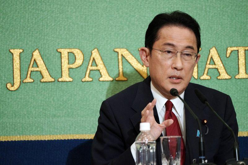 Japan's PM contender Kishida says won't raise sales tax for a decade
