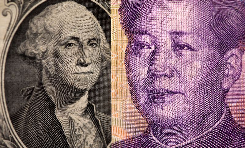 Dollar holds gains, yuan under pressure as Evergrande risks grow