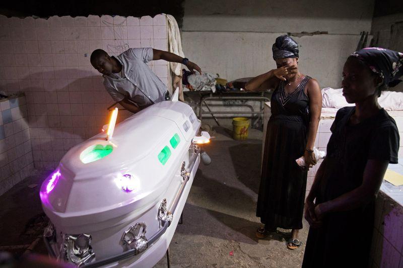 In Haiti, festive wakes and Voodoo undertakers help mourners say their last goodbyes