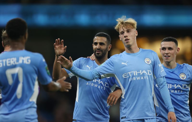 Soccer-Man City and Liverpool through but Everton out of League Cup