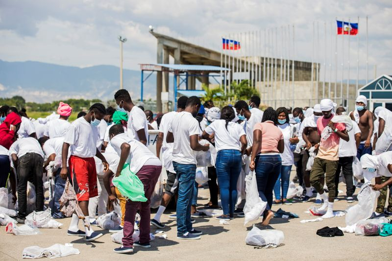 Angry scenes at Haiti airport add to Biden pressure over expulsions