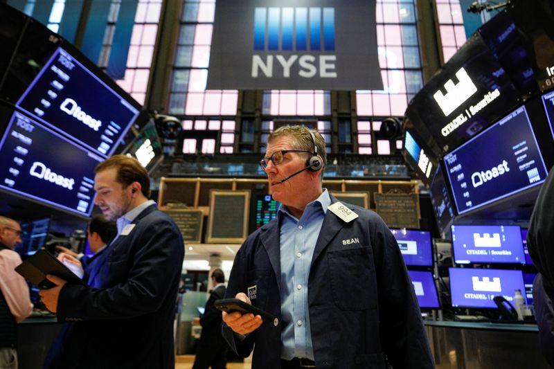 Уолл-стрит закрылась в плюсе после сигнала ФРС о сворачивании стимулов