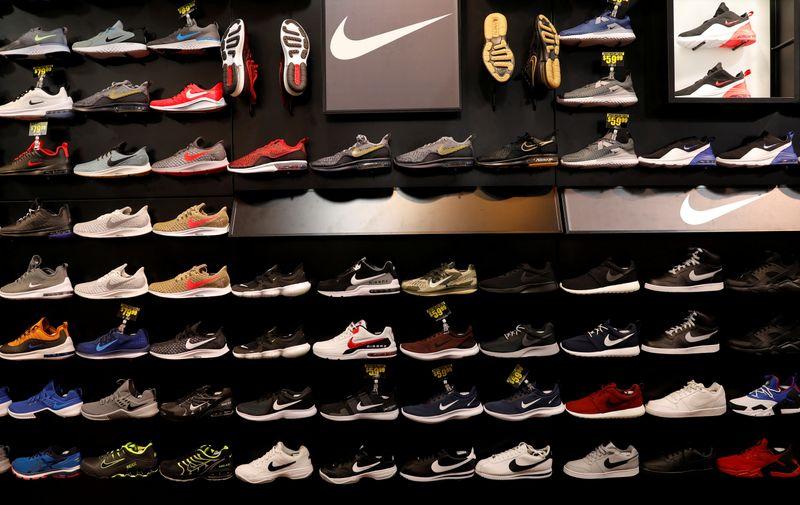Nike warns on holiday delays, cuts full-year sales estimate