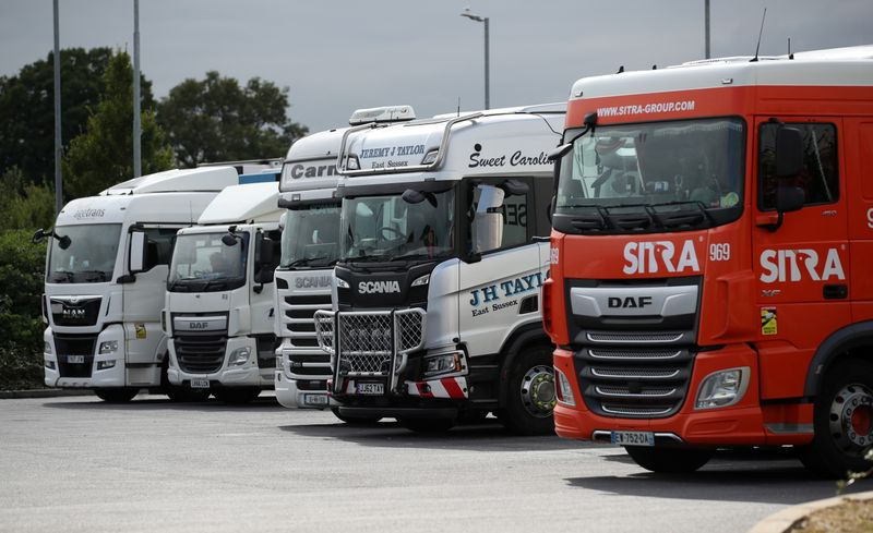 © Reuters. FILE PHOTO: Lorries are seen at an HGV parking, at Cobham services on the M25 motorway, Cobham, Britain, August 31, 2021. REUTERS/Peter Cziborra