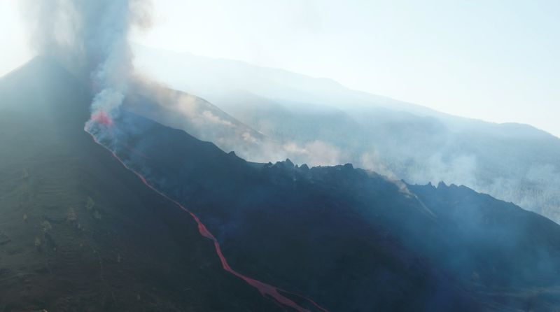 La Palma volcano spurts again as lava nears the sea