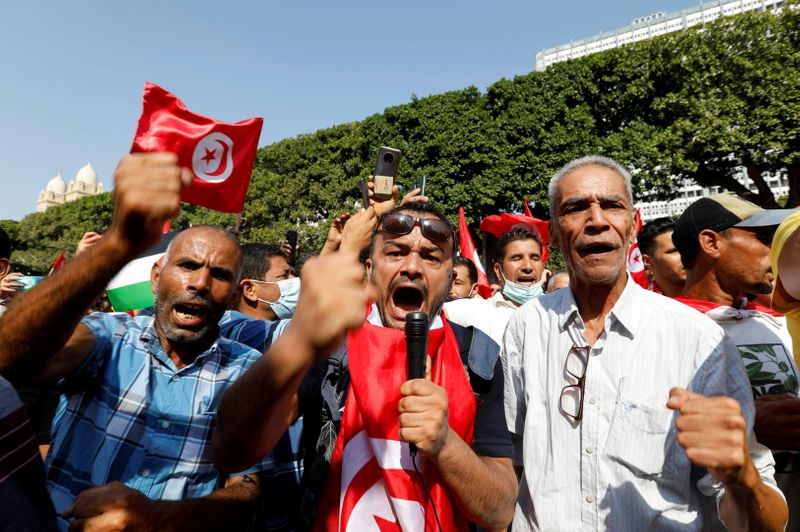 Backers of Tunisian president rally against 'coup' accusations