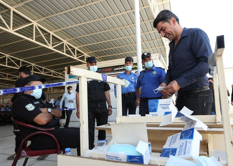 Soldiers, prisoners, displaced people vote early ahead of Iraq election