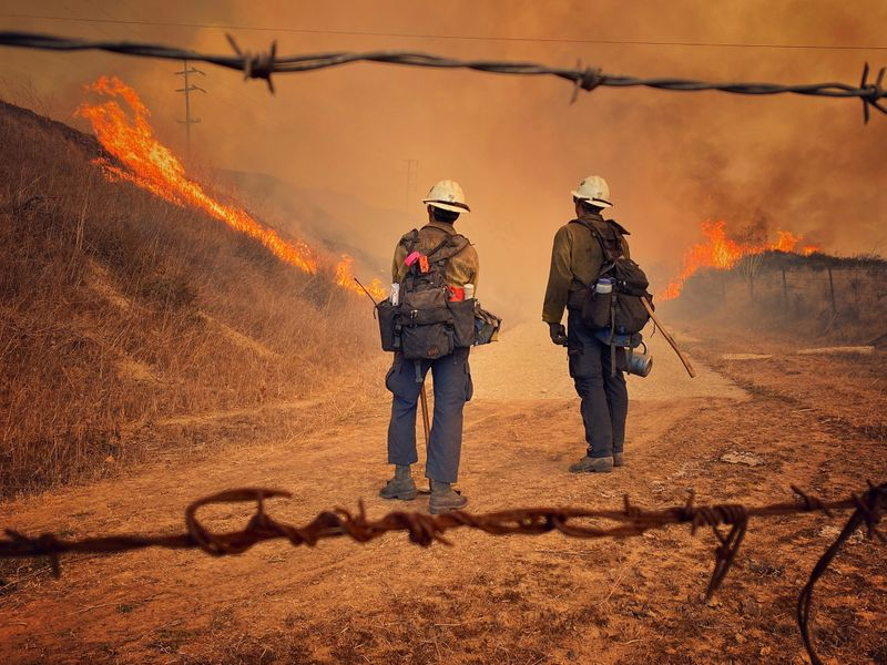 Planes, fire crews tackling wildfire near Reagan ranch in California