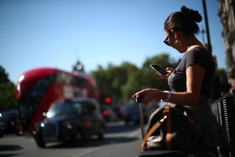 EU lawmakers' committee votes for bigger cuts in wholesale roaming fees