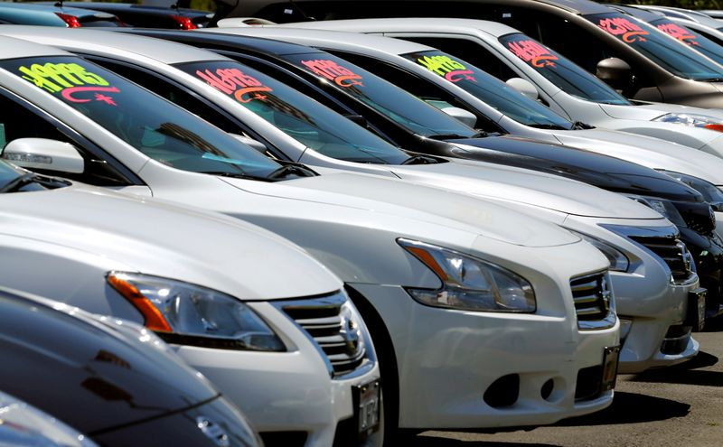 U.S. business inventories rise solidly, but auto stocks fall