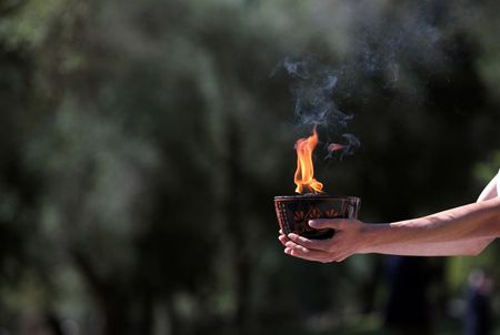 Olympics-Protest disrupts Beijing Games torch-lighting ceremony