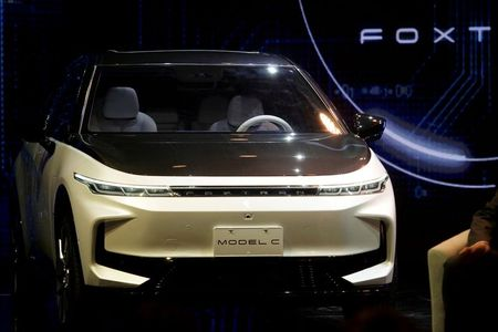 Carmakers shift up a gear in race to go electric