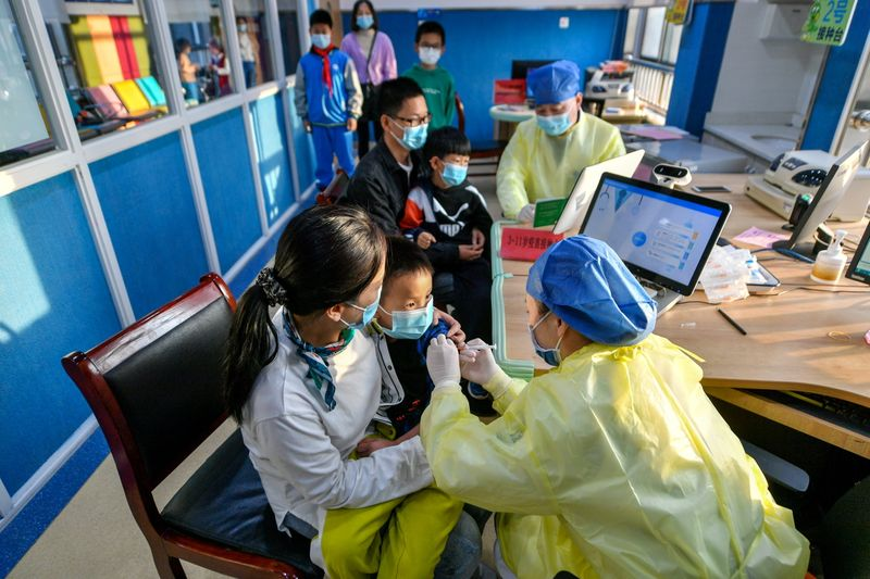 China's growing COVID-19 outbreak tests vulnerable border towns
