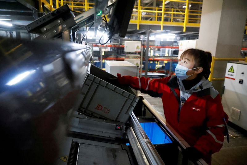 JD Logistics shares lose steam to close 3.3% higher