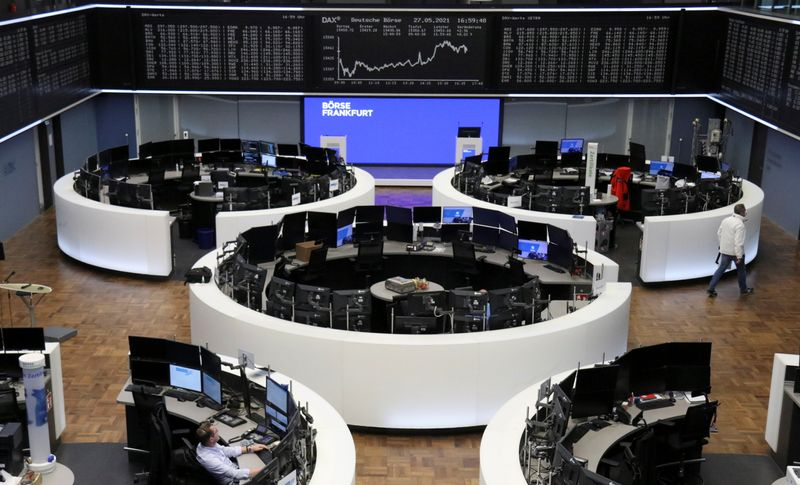 European shares at record high on gains in financials, U.S. spending plan