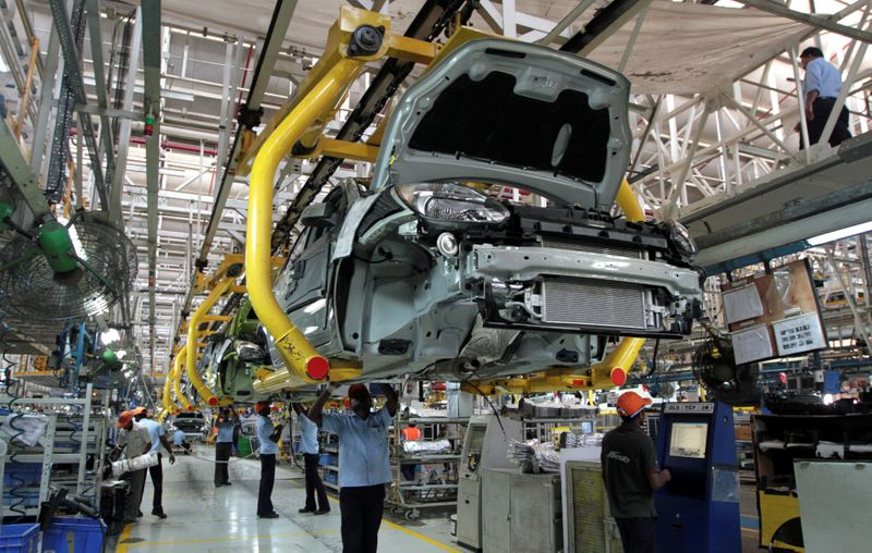 Carmakers in 'India's Detroit' allowed to operate as workers protest COVID risk
