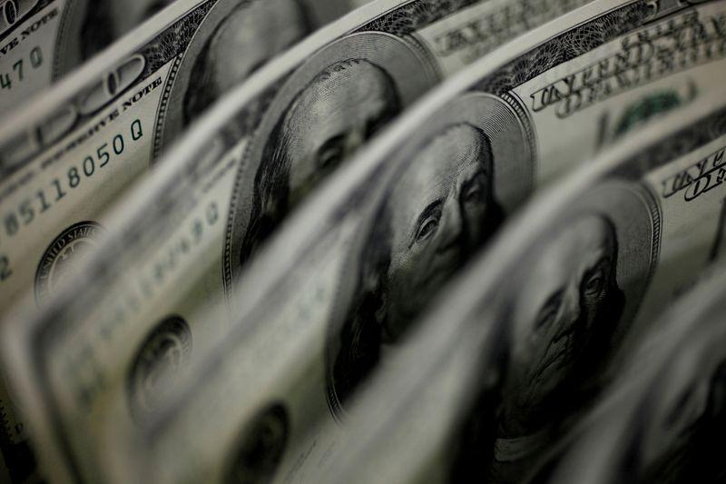 Dollar climbs to three-week peak in wake of strong U.S. data