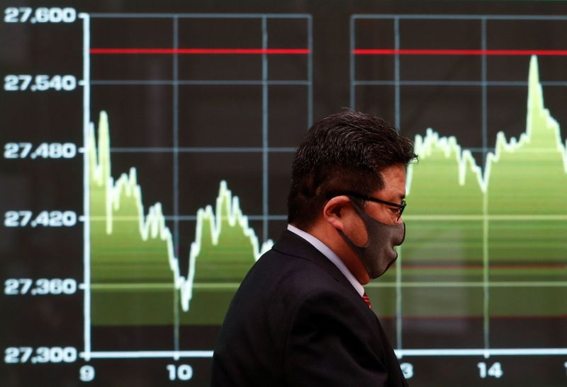Stocks up, dollar down as U.S. jobs data soothe rate hike fears