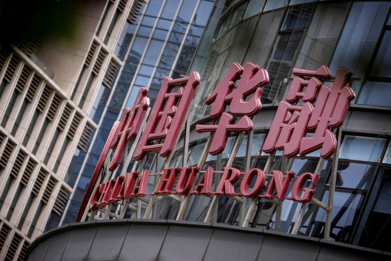 Exclusive: China pushes Huarong to sell non-core units, mulls implicit support - sources