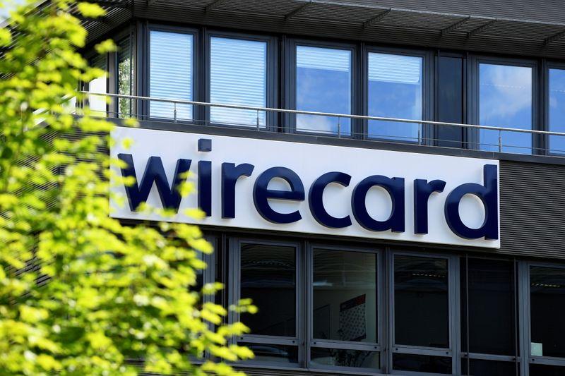 Scandale Wirecard: Un rapport parlementaire critique Scholz et Merkel