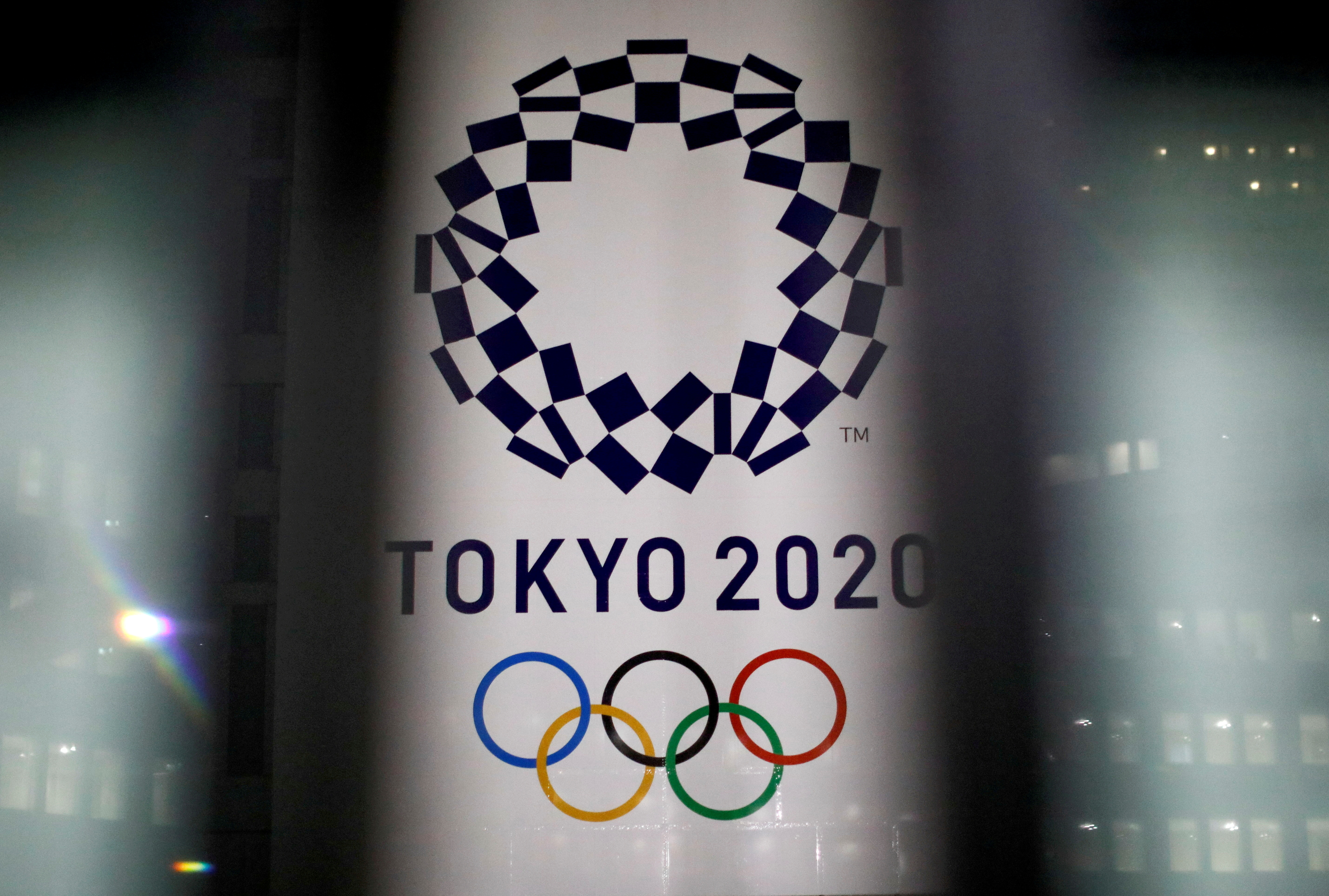 Olympics-Japan may keep some virus curbs until Games start -paper