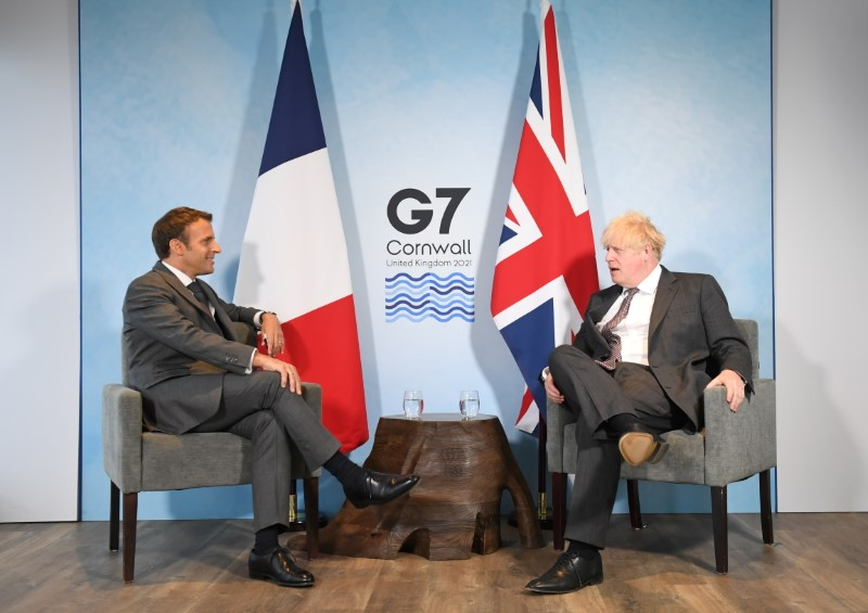 Exclusive-Macron offers UK's Johnson 'Le reset' if he keeps his Brexit word