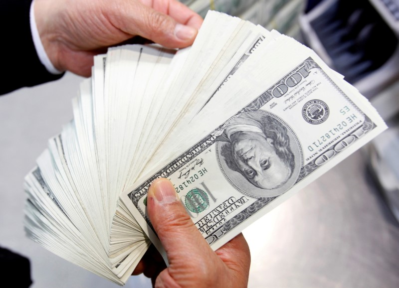 Dollar edges up after U.S. inflation data as traders await Fed outcome