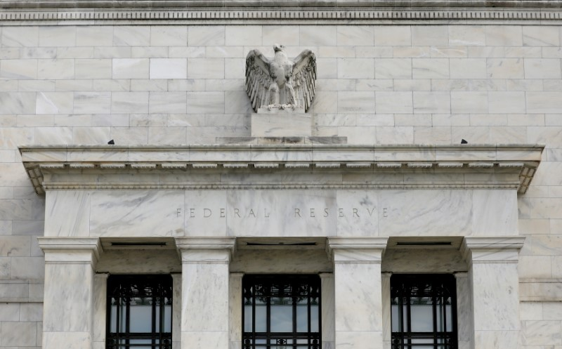 Fed signals higher rates in 2023, bond-buying taper talks as virus fades