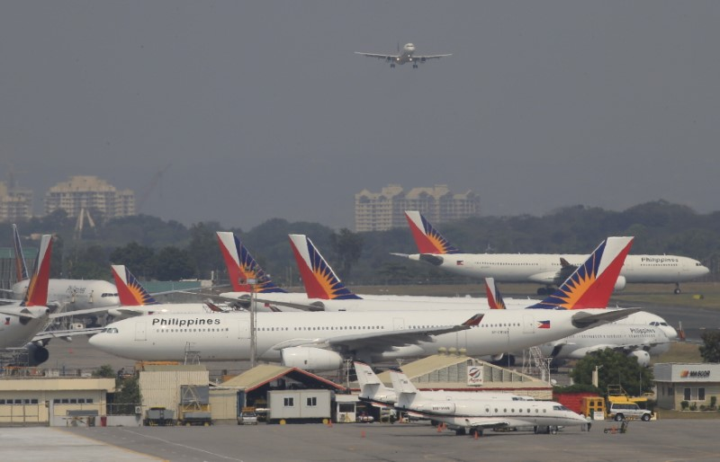 Philippine Airlines parent posts record loss, readies restructuring plan