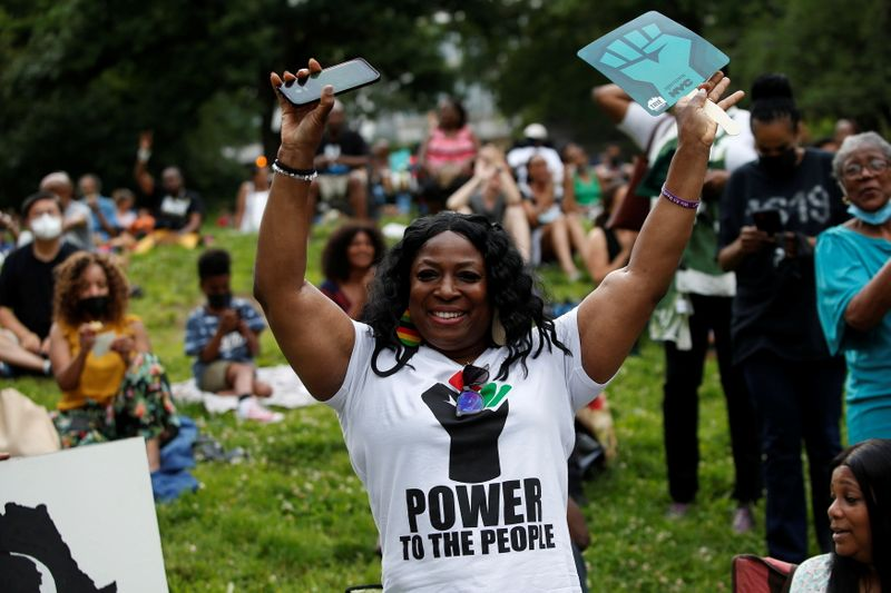 Cheers and quiet reflection as U.S. crowds mark Juneteenth