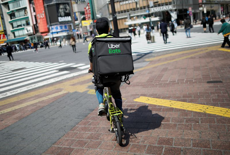 Japan police probe Uber Eats for suspected breach of immigration law - Kyodo