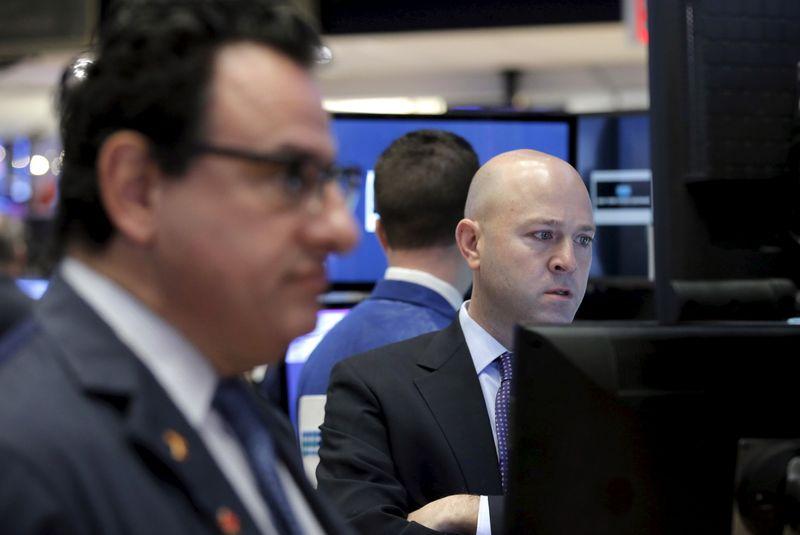 Wall Street finit en hausse, records du S&P-500 et du Nasdaq