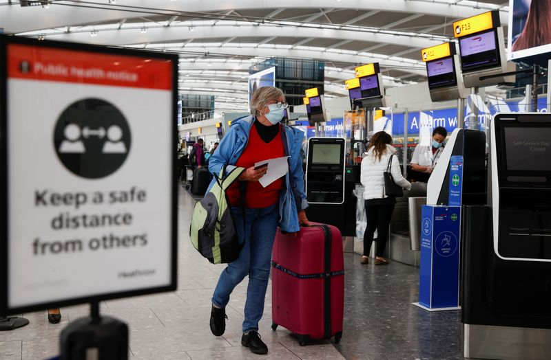 UK to publish plans to lift travel curbs for fully vaccinated