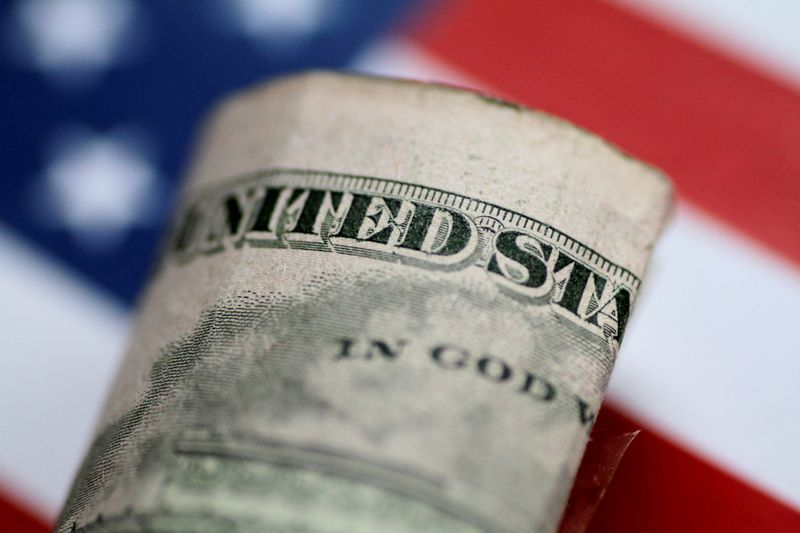 Dollar dips, but with a wary eye on U.S. inflation data