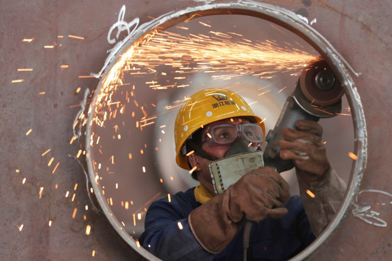 China's industrial profit growth slows amid high raw material prices
