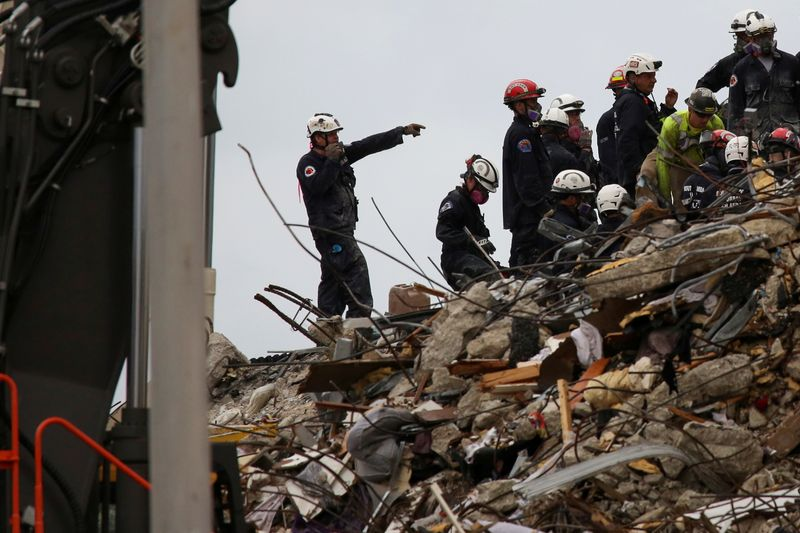 Second Florida building evacuated as death toll rises to 22 in condo tower collapse