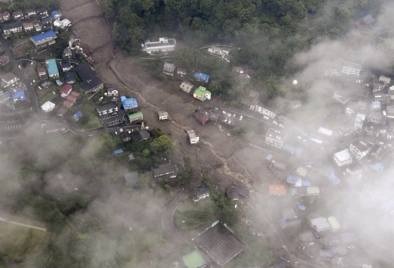 Japan rescue work continues after deadly landslides, 20 missing
